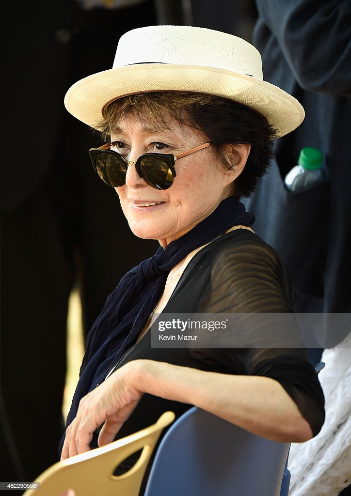 <a gi-track='captionPersonalityLinkClicked' href=/galleries/search?phrase=Yoko+Ono&family=editorial&specificpeople=202054 ng-click='$event.stopPropagation()'>Yoko Ono</a> attends Amnesty International Tapestry Honoring John Lennon Unveiling at Ellis Island on July 29, 2015 in New York City.