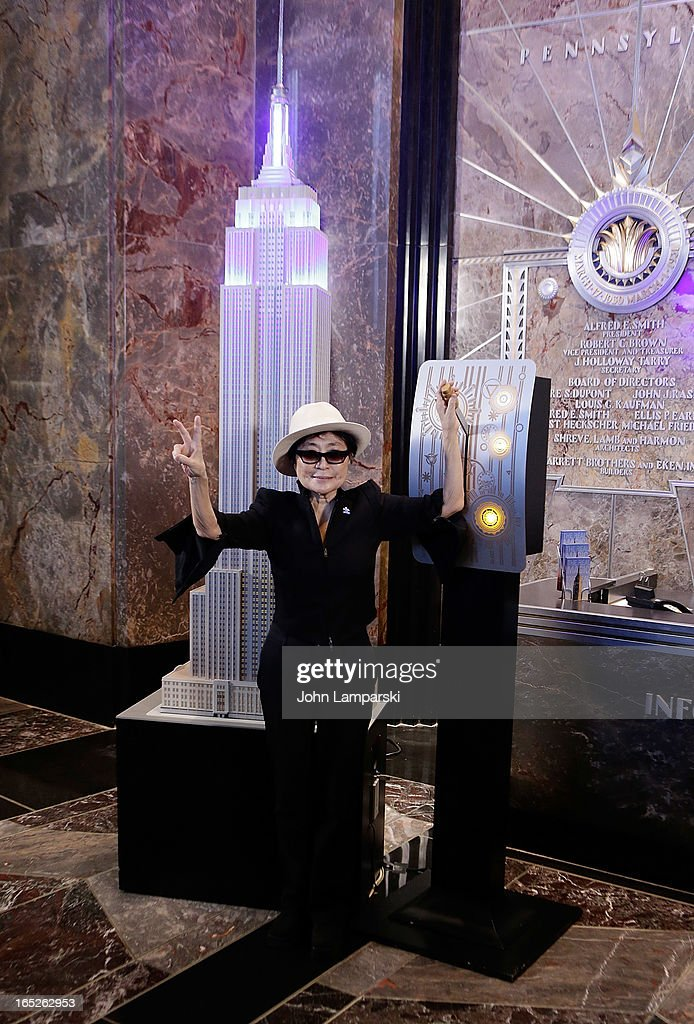 <a gi-track='captionPersonalityLinkClicked' href=/galleries/search?phrase=Yoko+Ono&family=editorial&specificpeople=202054 ng-click='$event.stopPropagation()'>Yoko Ono</a> attends 'World Autism Awareness Day' Celebration at The Empire State Building on April 2, 2013 in New York City.