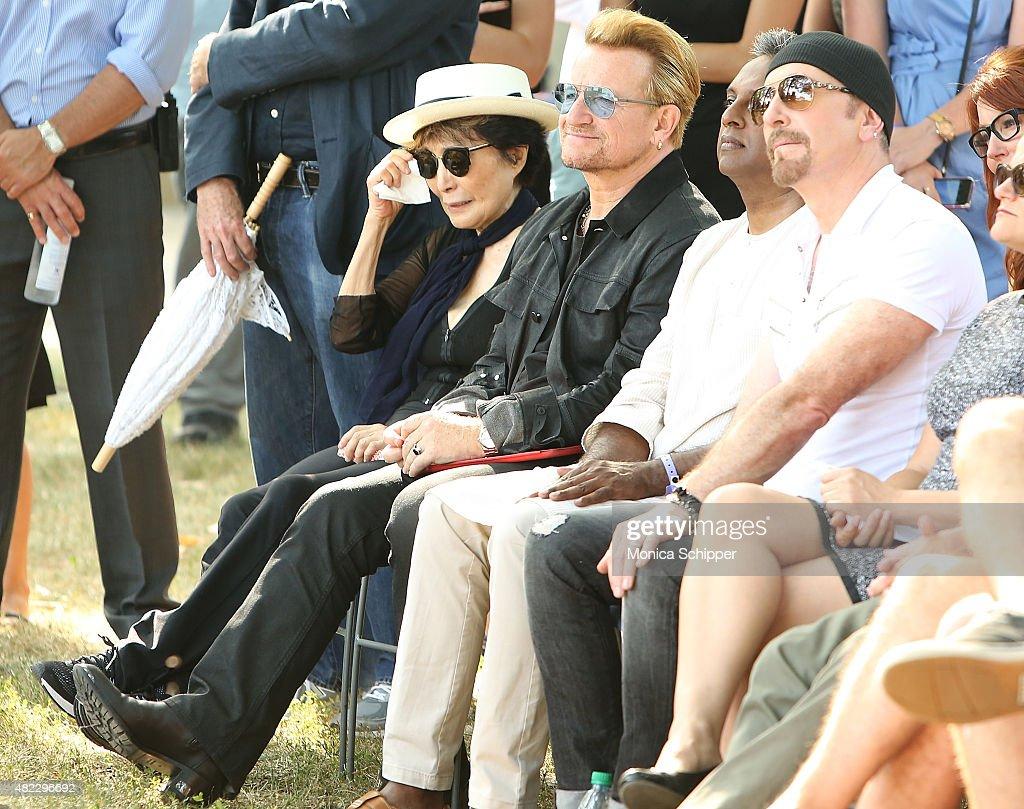 Yoko Ono, Bono, Salil Shetty and The Edge attend the Amnesty International Tapestry Honoring John Lennon Unveiling at Ellis Island on July 29, 2015 in New York City.