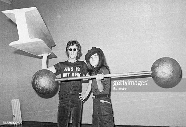 Yoko Ono right with assistance from her husband former Beatle John Lennon put the finishing touches to her first oneman show in the Everson Art...