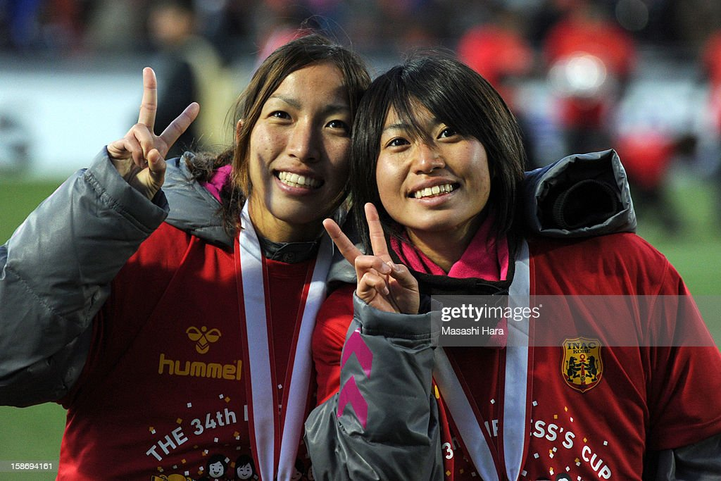 Yoko Tanaka #20 (R) and Emi Nakajima #19 of INAC Kobe Leonessa look on during the 34th Empress's Cup All Japan Women's Football Tournament final match between INAC Kobe Leonessa and JEF United Chiba Ladies at Nack 5 Stadium Omiya on December 24, 2012 in Saitama, Japan.