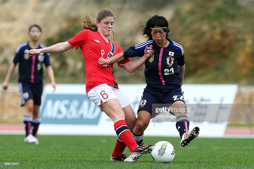 Yoko Tanaka MF of Japan challenges Maren Mjelde MF of Norway during the Algarve Cup match between Japan and Norway at the Complexo Desportivo Belavista on March 6, 2013 in Parchal, Portugal.