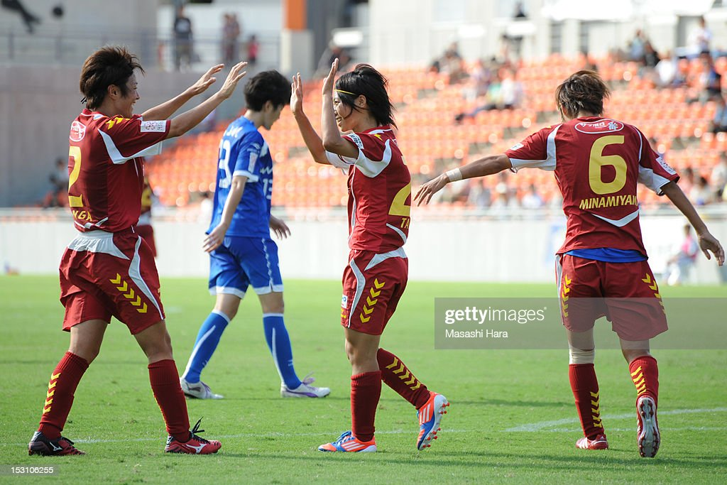 Yoko Tanaka #20 of INAC Kobe Leonessa (C) celebrates her goal with team-mates during the Nadeshiko League match between AS Elfen Sayama and INAC Kobe Leonessa at NACK 5 Stadium Omiya on September 30, 2012 in Saitama, Japan.