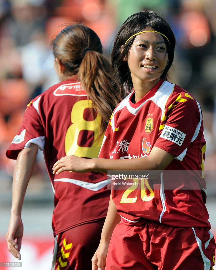 Yoko Tanaka (R) of INAC Kobe Leonessa celebrates their eighth goal during the Nadeshiko League match between AS Elfen Sayama and INAC Kobe Leonessa at NACK 5 Stadium Omiya on September 30, 2012 in Saitama, Japan.