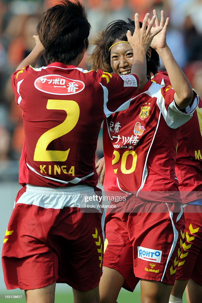Yoko Tanaka (R) of INAC Kobe Leonessa celebrates their eighth goal with her team mate <a gi-track='captionPersonalityLinkClicked' href=/galleries/search?phrase=Yukari+Kinga&family=editorial&specificpeople=4476938 ng-click='$event.stopPropagation()'>Yukari Kinga</a> during the Nadeshiko League match between AS Elfen Sayama and INAC Kobe Leonessa at NACK 5 Stadium Omiya on September 30, 2012 in Saitama, Japan.