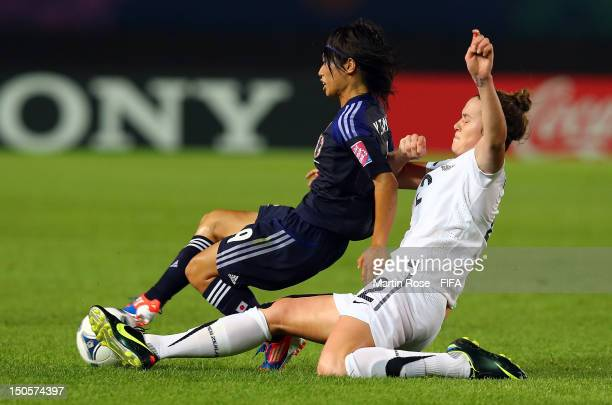 Yoko Tanaka of Japan and Bridgette Armstrong of New Zealand battle for the ball during the FIFA U20 Women's World Cup 2012 group A match between...