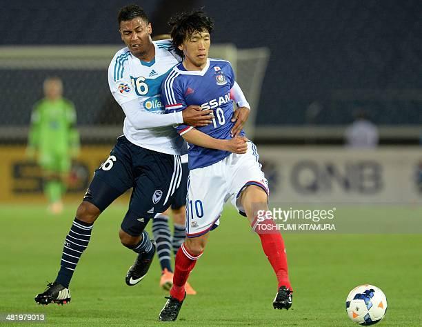 Yokohama F Marinos midfielder Shunsuke Nakamura fights for the ball with Melbourne Victory midfielder Rashid Mahazi during their AFC Champions League...