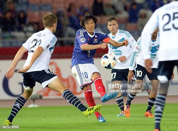 Yokohama F Marinos midfielder Shunsuke Nakamura shoots the ball among Melbourne Victory players during their AFC Champions League 2014 Group G...