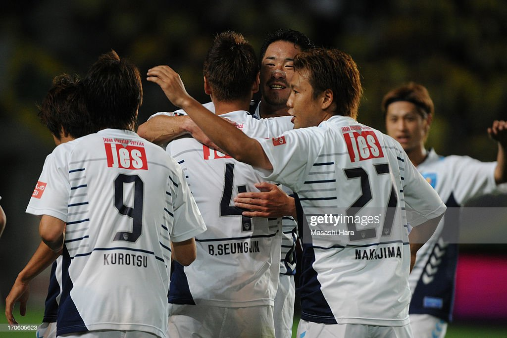 Yokohama FC players celebrate the first goal during the J.League second division match between JEF United Chiba and Yokohama FC at Fukuda Denshi Arena on June 15, 2013 in Chiba, Japan.