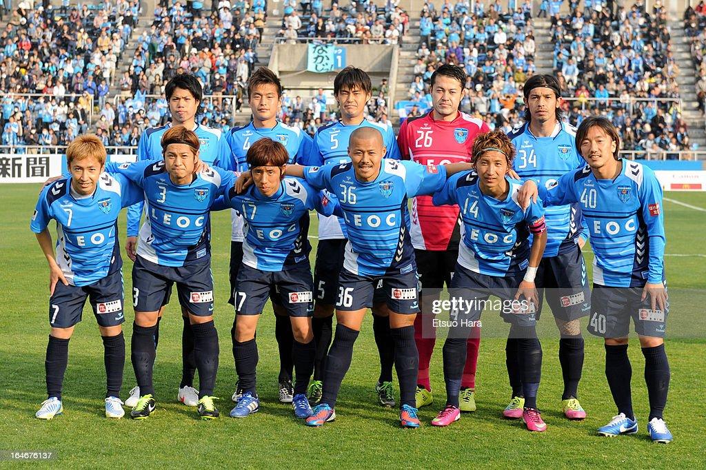 Yokohama FC Players line up for the team photos prior to the J.League Second Division match between Yokohama FC and Fagiano Okayama at Nippatsu Mitsuzawa Stadium on March 24, 2013 in Yokohama, Japan.