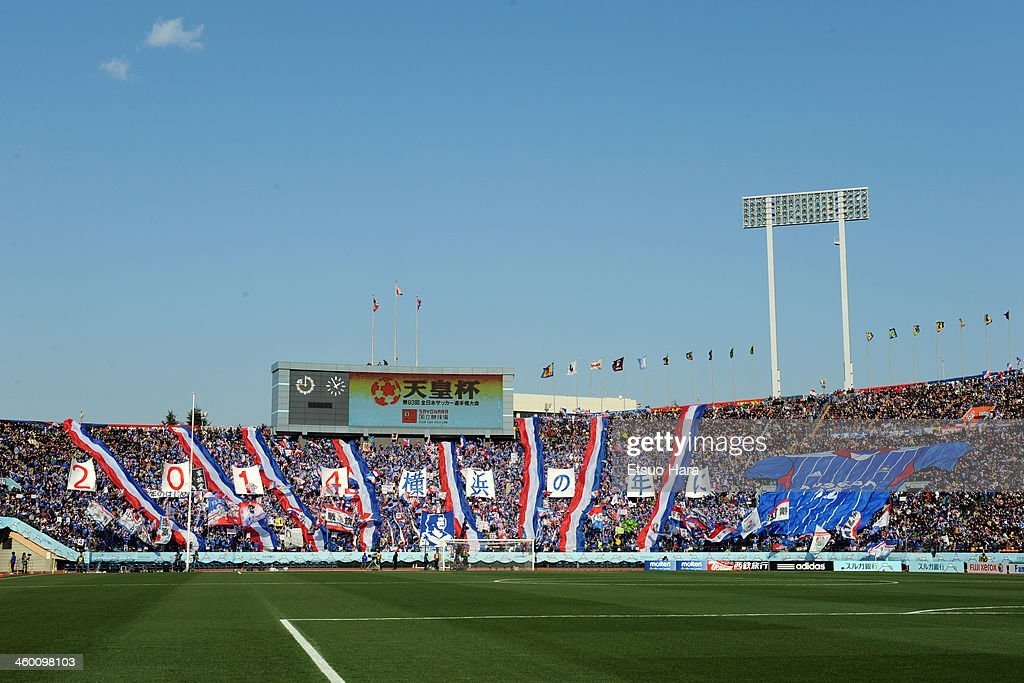 Yokohama F.Marinos fans cheer before the 93rd Emperor's Cup final between Yokohama F.Marinos and Sanfrecce Hiroshima at the National Stadium on January 1, 2014 in Tokyo, Japan.