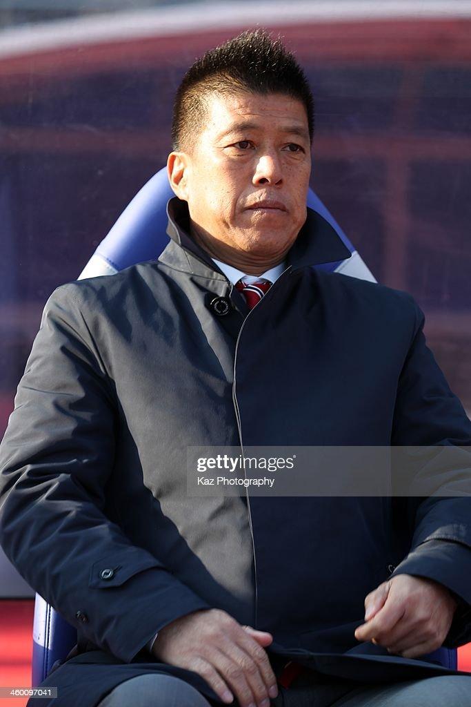 Yokohama F.Marinos head coach Yasuhiro Higuchi looks on before the 93rd Emperor's Cup final between Yokohama F.Marinos and Sanfrecce Hiroshima at the National Stadium on January 1, 2014 in Tokyo, Japan.
