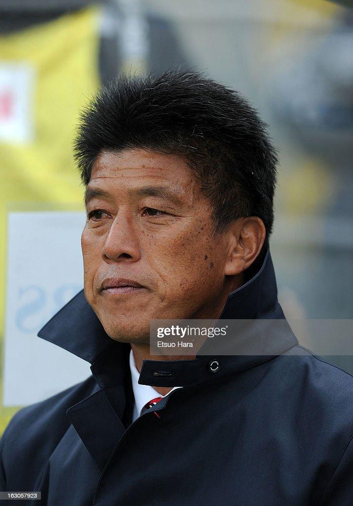 Yokohama F.Marinos manager Yasuhiro Higuchi looks on during the J.League match between Yokohama F.Marinos and Shonan Bellmare at Nissan Stadium on March 2, 2013 in Yokohama, Kanagawa, Japan.