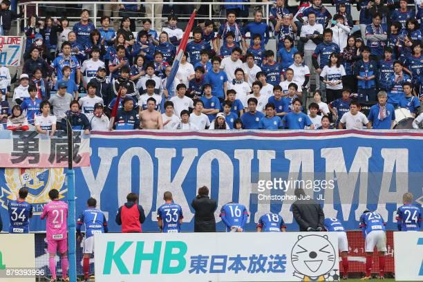 Yokohama FMarinos players applaud after the 22 draw in the JLeague J1 match between Vegalta Sendai and Yokohama FMarinos at Yurtec Stadium Sendai on...