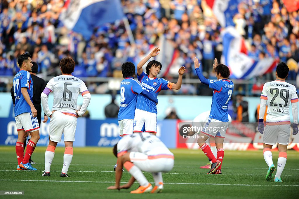Yokohama F.Marinos players celebrate the win after the 93rd Emperor's Cup final between Yokohama F.Marinos and Sanfrecce Hiroshima at the National Stadium on January 1, 2014 in Tokyo, Japan.