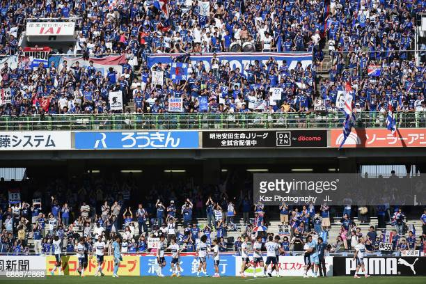 Yokohama FMarinos players celebrate their 31 victory in front of supporters after the JLeague J1 match between Shimizu SPulse and Yokohama FMarinos...