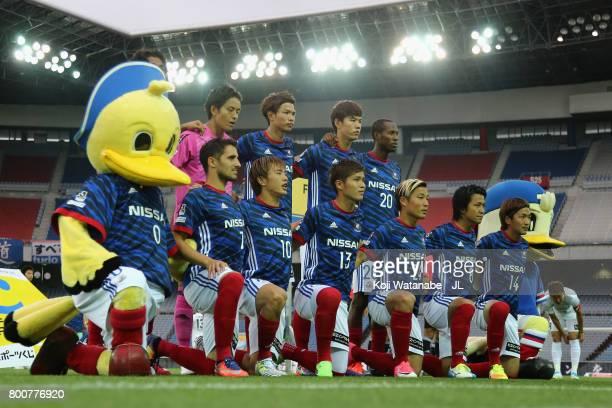 Yokohama FMarinos players line up for the team photos prior to the JLeague J1 match between Yokohama FMarinos and Vissel Kobe at Nissan Stadium on...