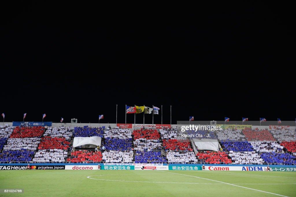 Yokohama F.Marinos supporters cheer prior to the J.League J1 match between Yokohama F.Marinos and Sagan Tosu at Nippatsu Mitsuzawa Stadium on August 13, 2017 in Yokohama, Kanagawa, Japan.