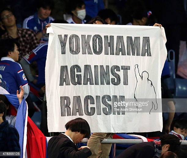 Yokohama FMarinos supporters hold a banner against raicism during the AFC Champions League Group G match between Yokohama FMarinos and Guangzhou...