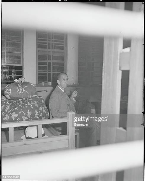 Japan War Criminal In U S Custody Nobusuke Kishi a member of the Japanese Cabinet at the time of the attack on Pearl Harbor sits beside his...
