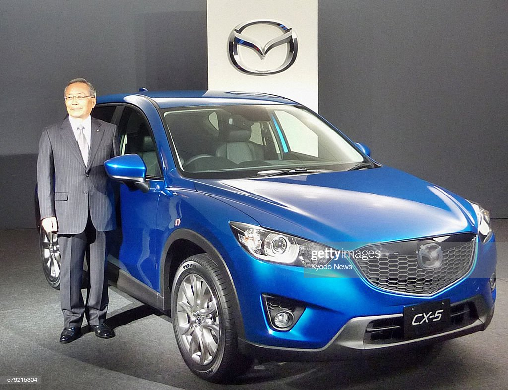 Yokohama Japan Mazda Motor Corp President Takashi Yamanouchi presents the CX5 a sportutility vehicle equipped with a clean diesel engine during a...
