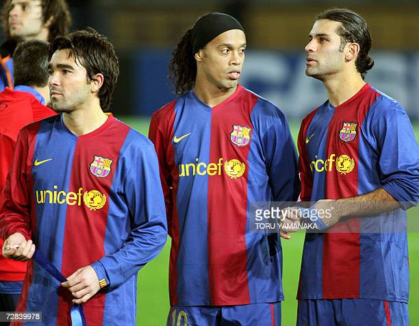 Spain's FC Barcelona midfielder Deco of Portugal forward Ronaldinho of Brazil and defender Rafael Marquez of Mexico show their dejection during the...