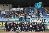 YSCC Yokohama players and staffs pose for photographs after the JLeague third division match between YSCC Yokohama and Gainare Tottori at Shonan BMW...
