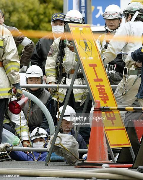 Yokosuka Japan Firefighters examine a sewer work site around a manhole in the Kurihama district in the city of Yokosuka Kanagawa Prefecture on Jan 10...