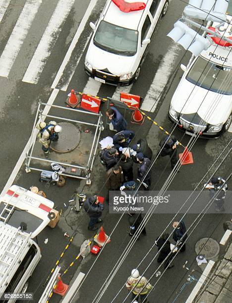 Yokosuka Japan Photo taken from a Kyodo News helicopter shows investigators examining a sewer work site around a manhole in the Kurihama district in...