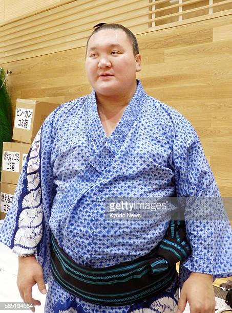 Yokozuna Hakuho of Mongolia speaks to reporters in the city of Fukui on Aug 2 about his memories of former yokozuna Chiyonofuji who died due to...