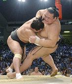 Yokozuna Harumafuji defeats promotionchasing ozeki Kisenosato on July 22 the 13th day of the Nagoya Grand Sumo Tournament taking a major step toward...