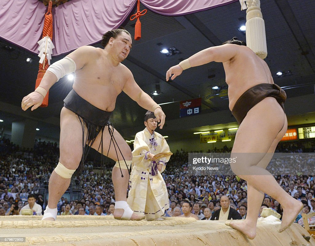 Yokozuna Harumafuji of Mongolia pushes compatriot yokuzuna Hakuho out of the ring on the final day of the Nagoya Grand Sumo Tournament at Aichi...