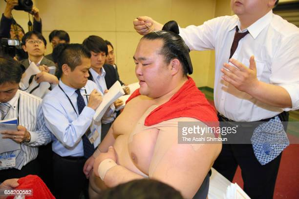 Yokozuna Kisenosato speaks to reporters in the dressing room after winning the tournament during day fifteen of the Grand Sumo Spring Tournament at...