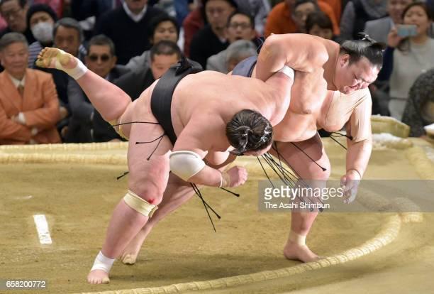 Yokozuna Kisenosato throws Mongolian ozeki Terunofuji to win the tournament at the championship playoff during day fifteen of the Grand Sumo Spring...