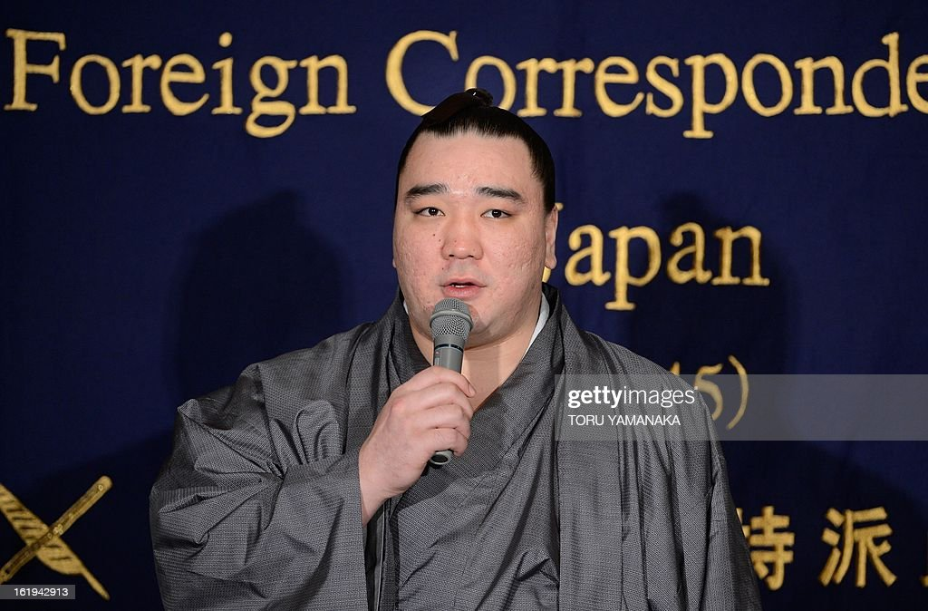 'Yokozuna', or grand champion, Harumafuji of Mongolia speaks at a press conference at the Foreign Correspondents' Club in Tokyo on February 18, 2013. Harumafuji, a relative lightweight at only 133 kilogrammes (293 pounds), was promoted to the top rank of the sport -- yokozuna -- last September, joining his compatriot Hakuho who had been the lone grand champion for three years. AFP PHOTO / Toru YAMANAKA
