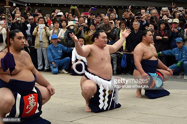 Yokozuna or grand champion of sumo Hakuho performs the ceremonial entrance into the ring at the Yasukuni shrine in Tokyo on April 3 2015 Sumo...