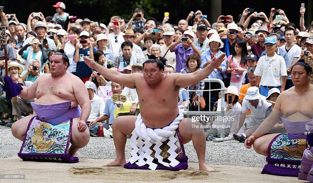 Yokozuna, sumo grand champion <a gi-track='captionPersonalityLinkClicked' href=/galleries/search?phrase=Hakuho&family=editorial&specificpeople=625611 ng-click='$event.stopPropagation()'>Hakuho</a> performs the 'Dohyo-iri', ring purification ritual at Atsuta Jingu Shrine on July 5, 2014 in Nagoya, Aichi, Japan.