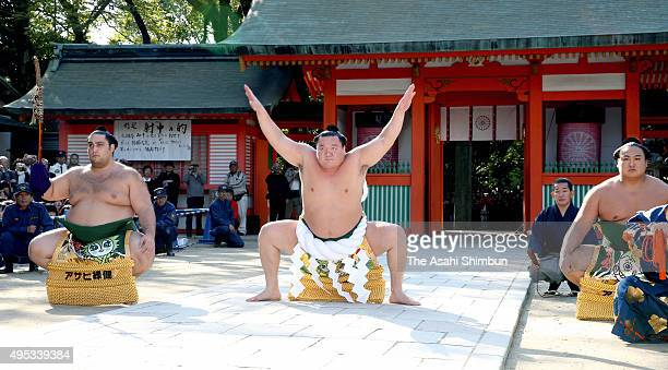 Yokozuna sumo grand champion Hakuho performs the 'DohyoIri' ring purification ritual ahead of the Kyushu Tournament at Sumiyoshi Jinja Shrine on...