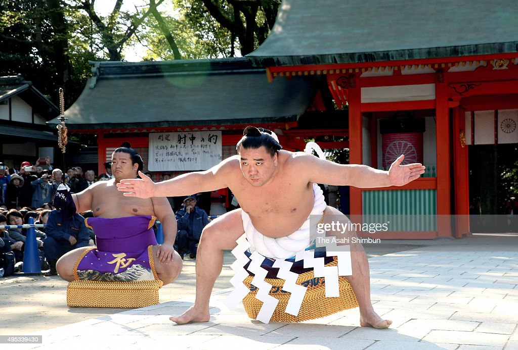 Yokozuna sumo grand champion Harumafuji performs the 'DohyoIri' ring purification ritual ahead of the Kyushu Tournament at Sumiyoshi Jinja Shrine on...