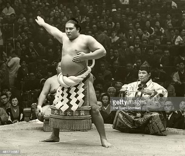 Yokozuna sumo's grand champion Taiho performs the 'DohyoIri' ring purification ritual during the Grand Sumo Spring Tournament at Osaka Prefecture...