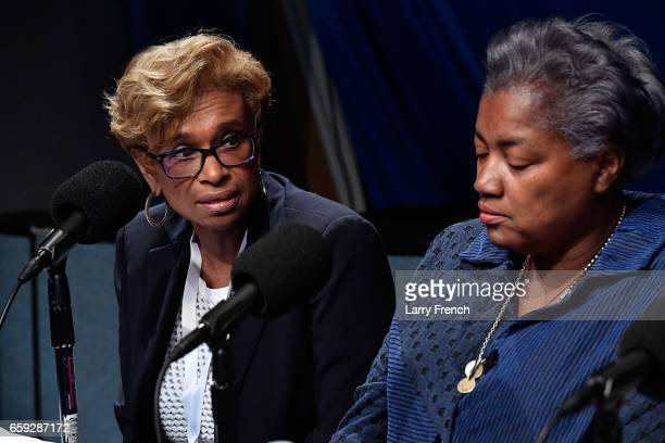 Yolanda Caraway speaks while Donna Brazile looks on during SiriusXM's Progress Channel Presents For Colored Girls Who Have Considered Politics A...