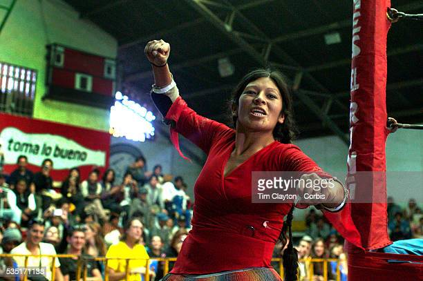 Yolanda La Amorosa celebrates her victory over her male Counterpart during the 'Titans of the Ring' wrestling group's Sunday performance at El Alto's...