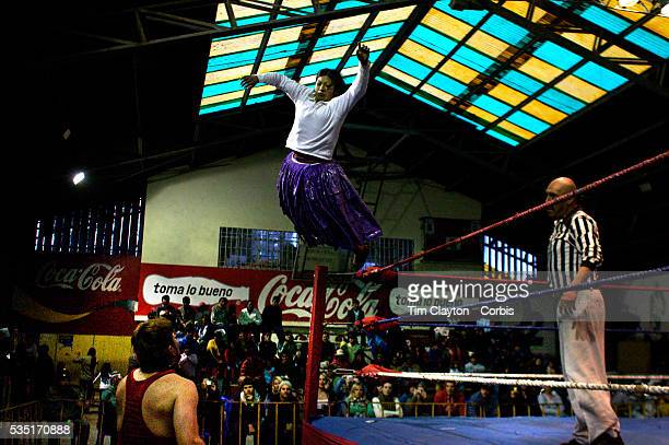 Yolanda la Amorosa dives onto her male counterpart during the 'Titans of the Ring' wrestling group's Sunday performance at El Alto's Multifunctional...