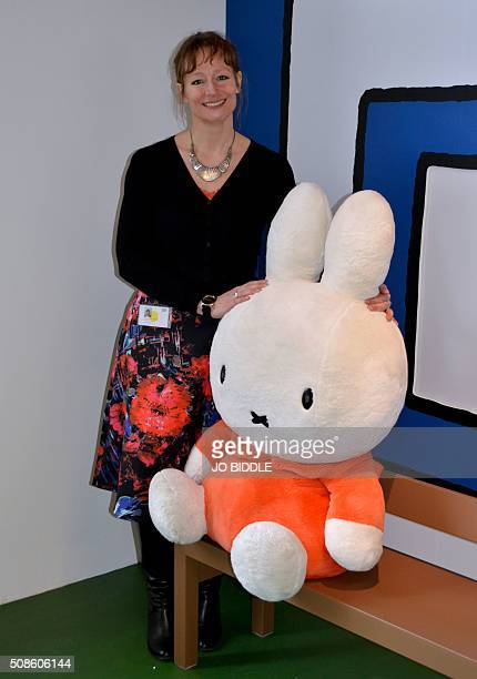 Yolanda van den Berg curator of the Miffy Museum poses with a stuffed Miffy toy at the museum in Utrecht To some she's just a plain white bunny to...
