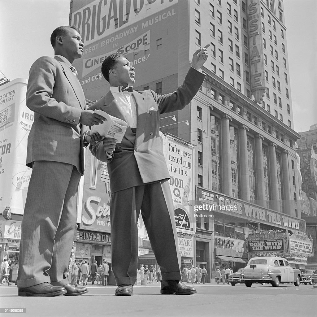 Yolande Pompee British middleweight and light heavyweight from Trinidad points out a Times Square highlight to his fellow countryman Hector Constance...