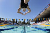 Yolane Kukla launches off the block for the start of the 18th heat of the womens 50 meter freestyle prelims at the XLIII Santa Clara International...