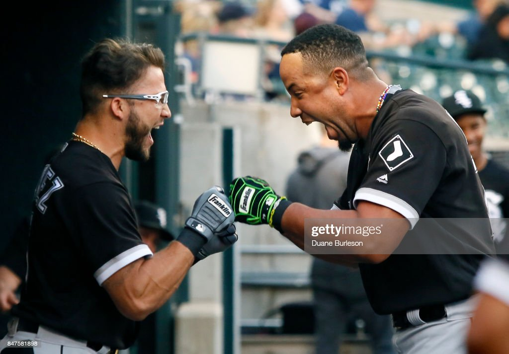 Yolmer Sanchez #5 and Jose Abreu #79 of the Chicago White Sox fist bump before a game against the Detroit Tigers at Comerica Park on September 15, 2017 in Detroit, Michigan.
