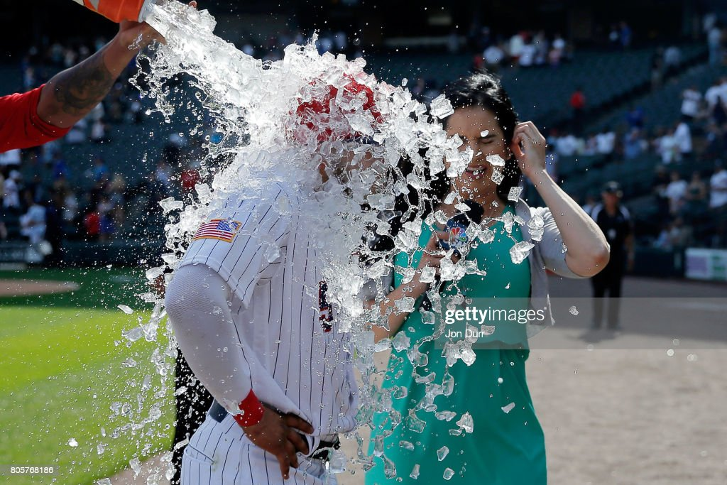 Yolmer Sanchez #5 of the Chicago White Sox is dunked after their win over the Texas Rangers at Guaranteed Rate Field on July 2, 2017 in Chicago, Illinois. The Chicago White Sox won 6-5.