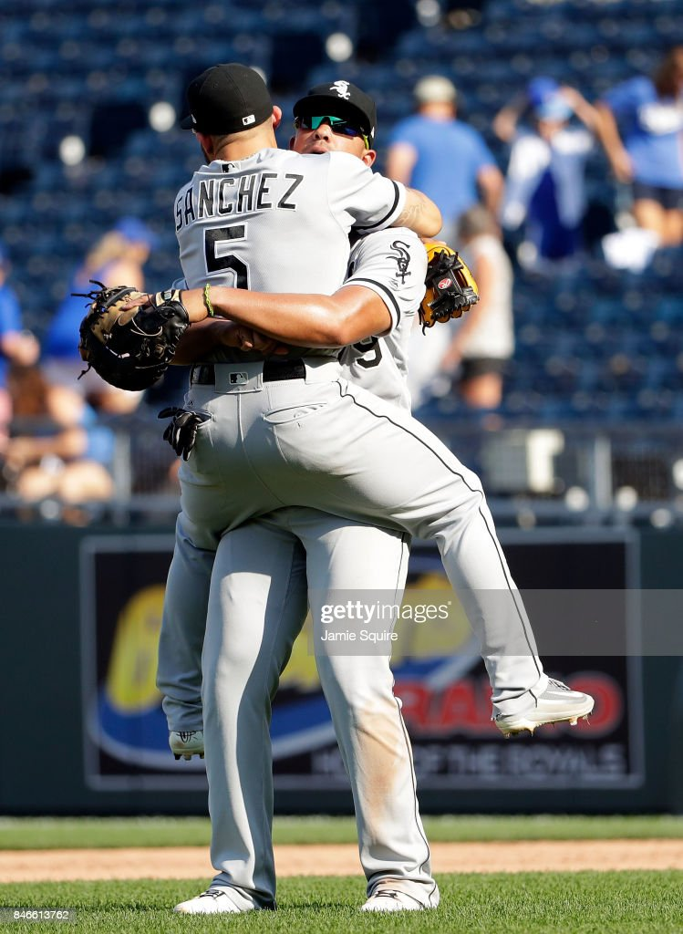 Yolmer Sanchez #5 of the Chicago White Sox is picked up by Jose Abreu #79 after the White Sox defeated the Kansas City Royals5-3 to win the game at Kauffman Stadium on September 13, 2017 in Kansas City, Missouri.