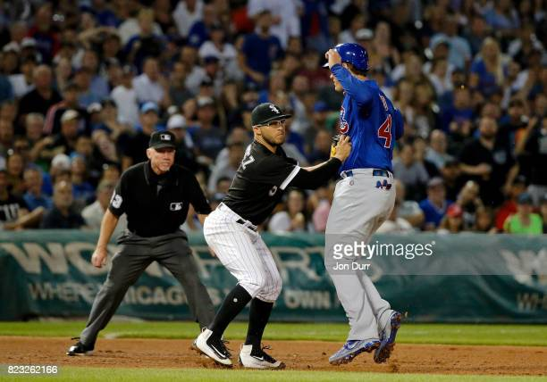 Yolmer Sanchez of the Chicago White Sox tags out Anthony Rizzo of the Chicago Cubs after a run down during the fifth inning at Guaranteed Rate Field...